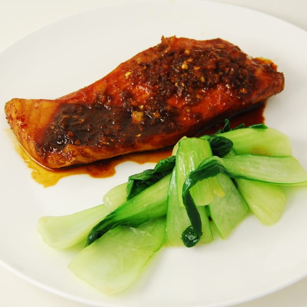 salmon cooked with kecap manis, lime & sambal with pak choy