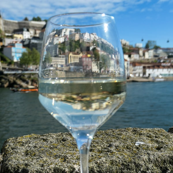 glass of wine in porto on the duoro river